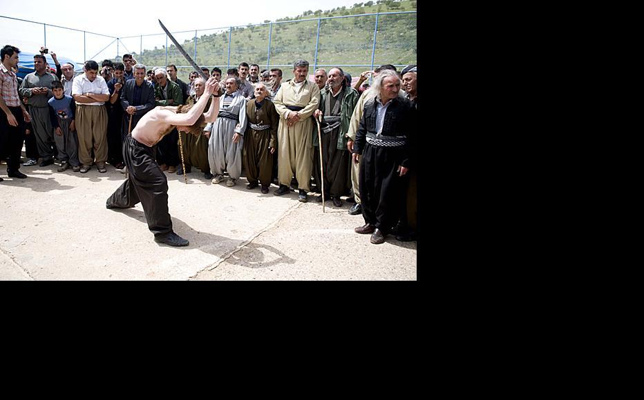 Khalid Konapowshi, 25, of Marivan, Iran, performs self-flagellation at the Sufi festival in the mountains of Iraqi Kurdistan, near the border with Iran. Photo by Aram Karim/Metrography.