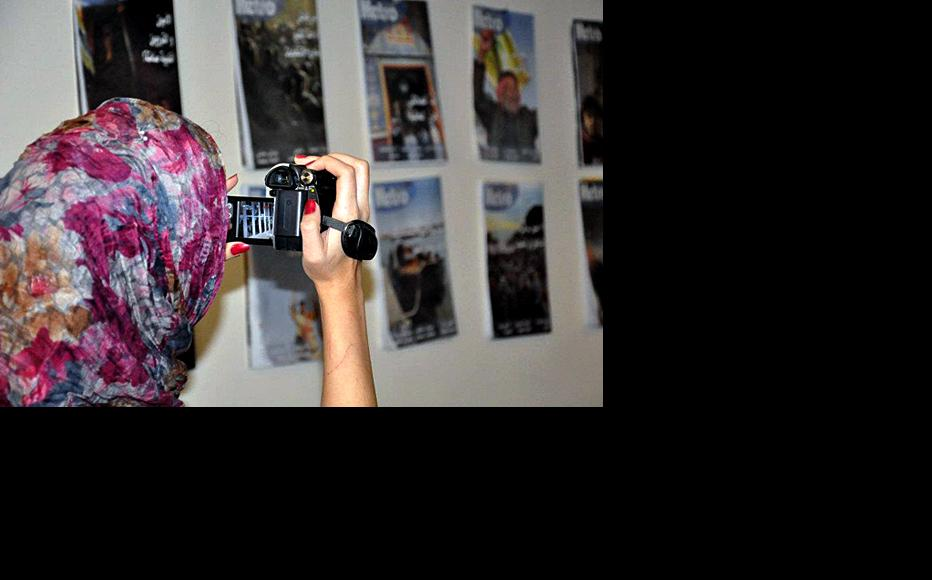 A trainee gets to grip with a camera. (Photo: IWPR)
