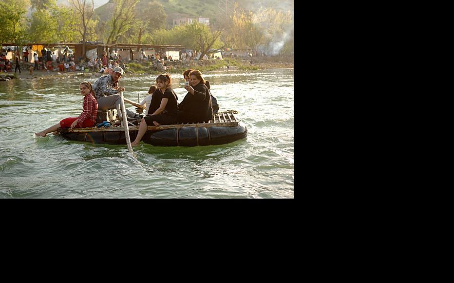 A family enjoys a boat trip on Dukan lake.