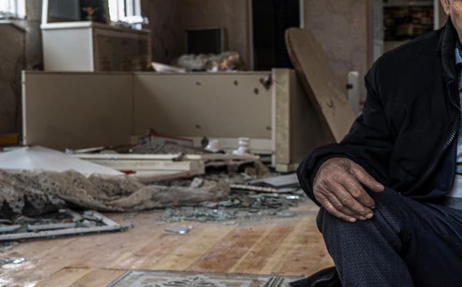 Etibar Huseynov, 58, sits in his house, which was hit by heavy artillery shelling during the war. He and his wife have been forced to live in a small room of the house, the only one that is still more or less intact, as they wait for the government to repair the house.