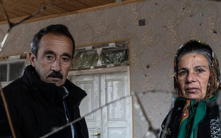 Etibar Huseynov and his wife Farida Huseynova in their war damaged house.