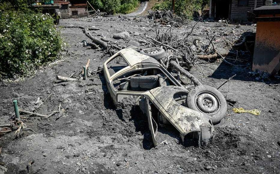 A vehicle picked up and spat out by mudflows in Topcic Polje. May 21, 2014.