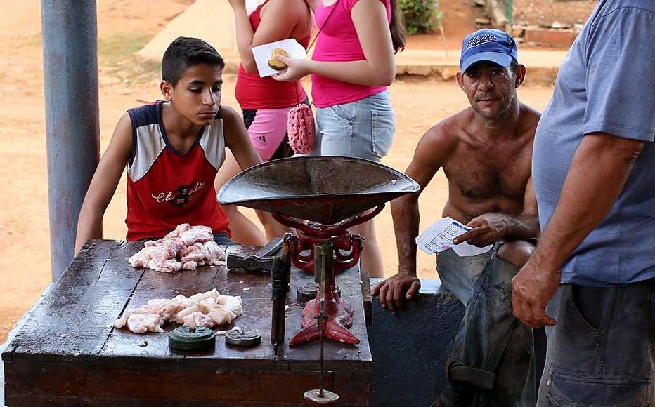 Farmers selling pork meat on the veranda.