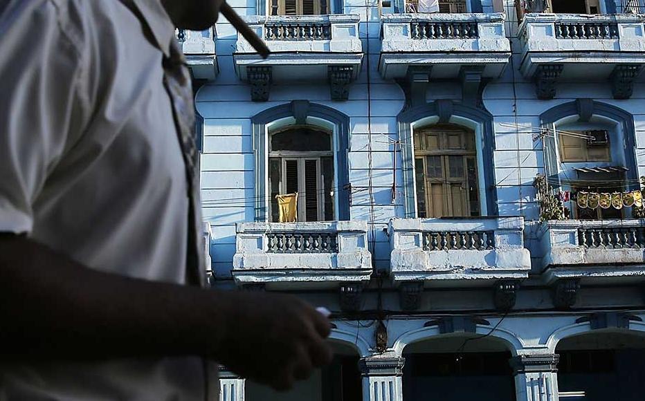 A pedestrian walks along a street as Cuba prepares for the visit of US president Barack Obama.