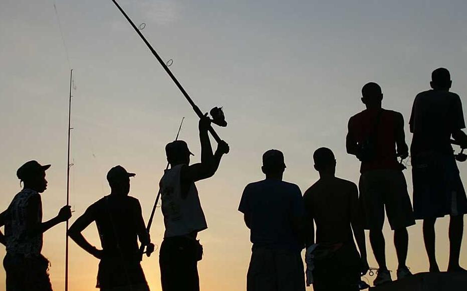 Fishermen line the Malecon in Havana.