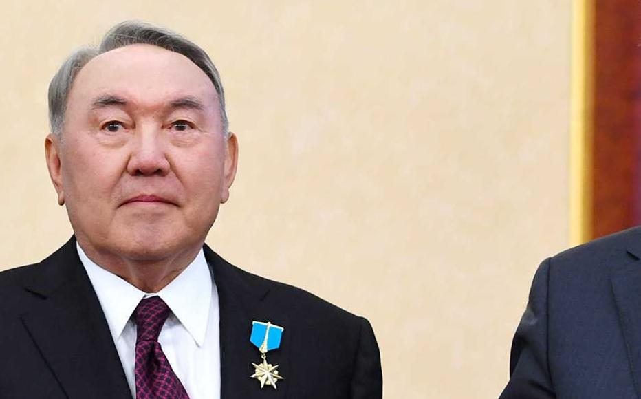 Nazarbayev and Kassym-Zhomart Tokayev during the handover ceremony.