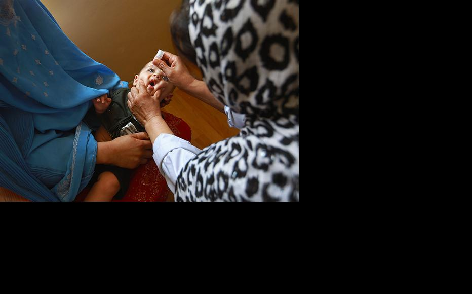 An Afghan child receives a polio vaccine at a clinic in Farza. (Photo: John Moore/Getty Images)