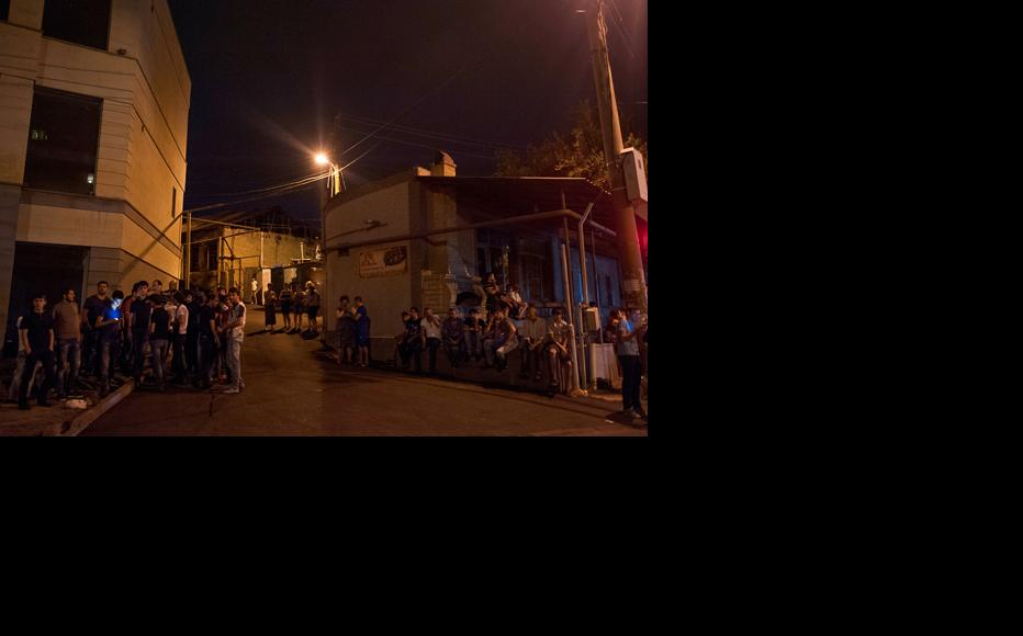 Residents who live near the blocked streets are watching the situation. (Photo: Nazik Armenakyan)