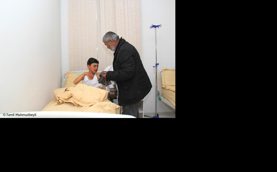 Sanan Valizade, 13, was wounded when shells hit the village of Seyidimli, located 300 metres from a military position. (Photo: Famil Mahmudbeyli)
