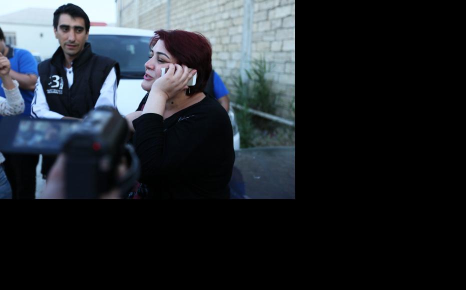 Ismayilova receives congratulatory phone calls immediately after her release. (Photo: Aziz Karimov)