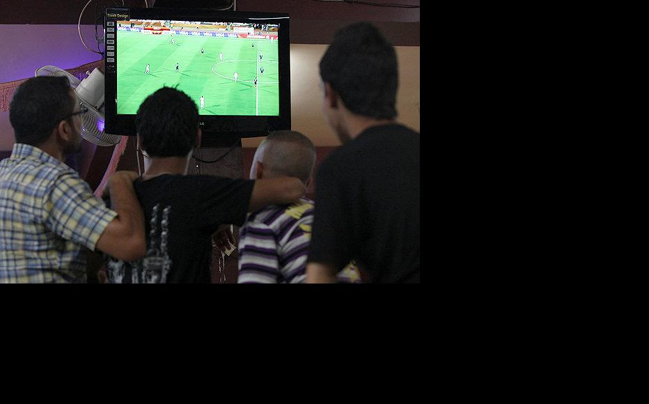 Football fans in Baghdad gather at a coffee shop to watch World Cup action. (Photo: Sirwan Aziz)
