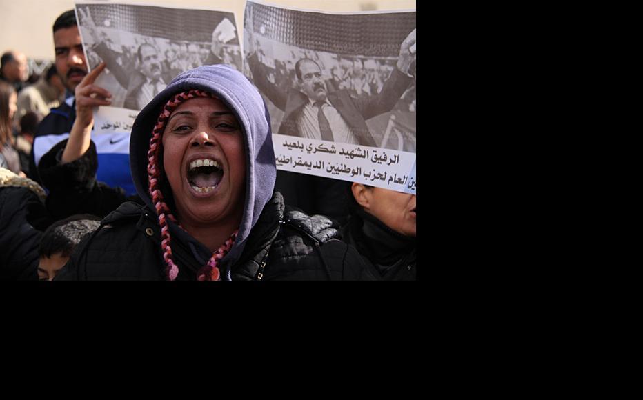 Mourner at Chokri Belaid's funeral, February 8. (Photo: Rabii Kalboussi)