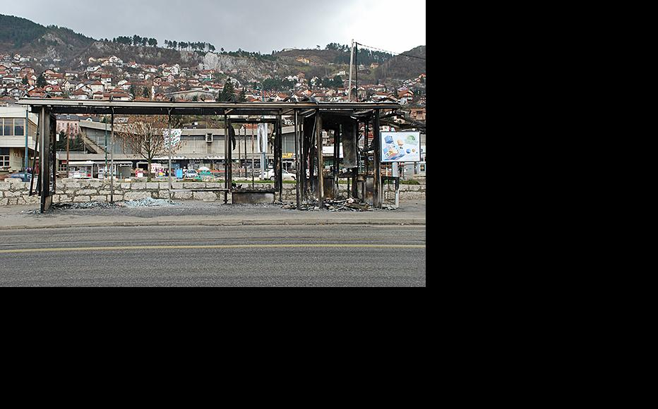 Burnt-out ruins of a tram stop and kiosk two days after Sarajevo riots. February 9, 2014. (Photo: Jim Marshall)