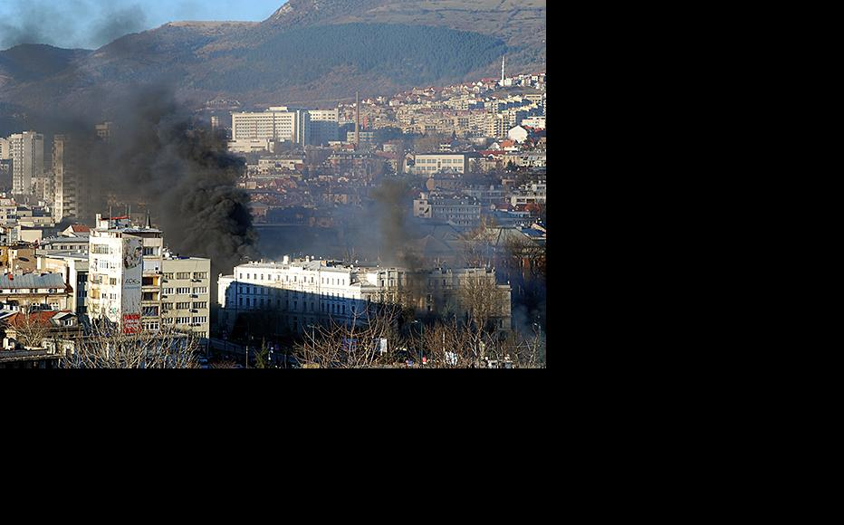 Fire takes hold in the building of the Centar Municipality in Sarajevo, February 7, 2014. (Photo: Jim Marshall)