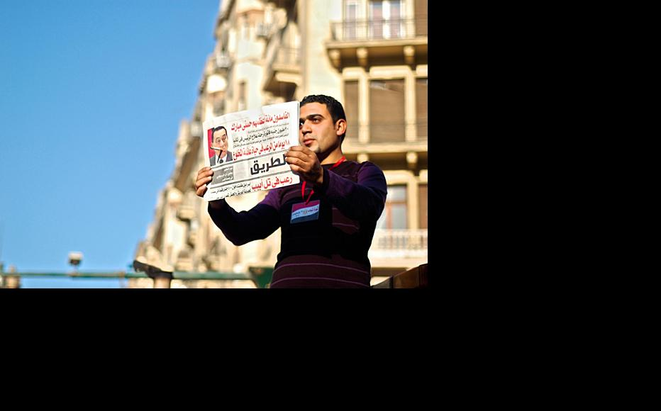 An Egyptian protester pokes fun at Hosni Mubarak during the February protests in central Cairo. (Photo: Ahmed al-Hilali/Flickr)