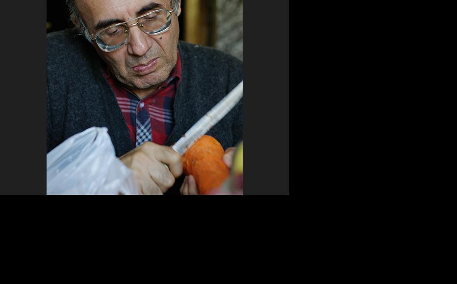Abdumalik Mamirov, an ethnic Uighur from Kazakstan, is making plov in his house in Almaty. (Photo: Aziz Mamirov)