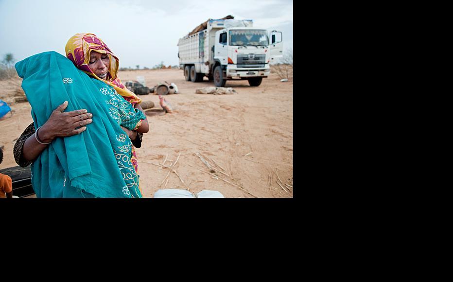 Displaced people returning home in Darfur under UNHCR's voluntary programme. (Photo: UN Photo/Albert Gonzalez Farran)