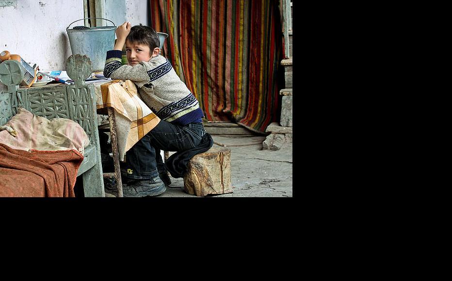 The spot where Gigi is doing his homework was submerged during the April 2010 flood. (Photo: Giorgi Kupatadze)