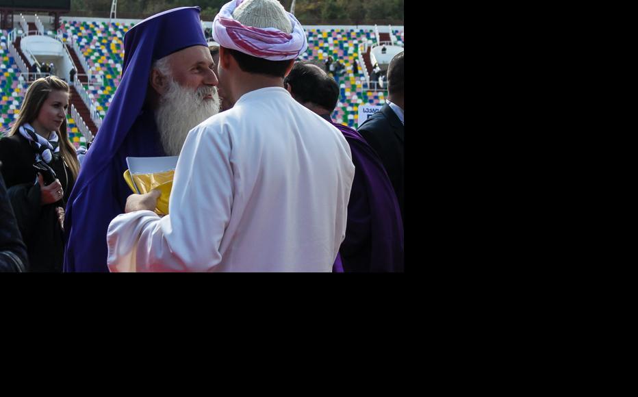 Malkhaz Songhulashvili, archbishop of the Evangelical-Baptist Church, talks to a leader of the Yazidi Religious Union. (Photo: Tamar Svanidze)