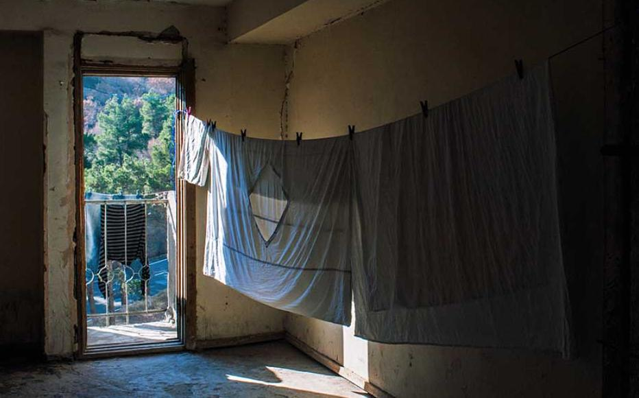 Laundry drying in a common hallway.