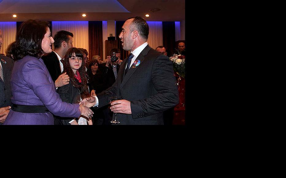 Kosovo president Atifete Jahjaga greets Ramush Haradinaj on his return from The Hague. (Photo: Kosovo president's official website.)