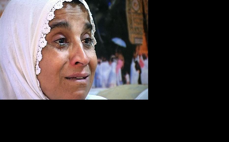 A tearful Sahera Ibrahim speaks about the day in 2006 when her son was taken away by an armed and uniformed group and never heard from again. (Photo: Ibraheim Saleh)