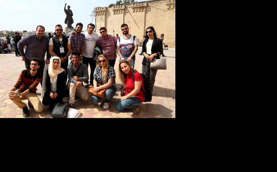 IWPR staff, members of RAIN organisation and the artists at al Mutanabbi Street in Baghdad. (Photo: IWPR)