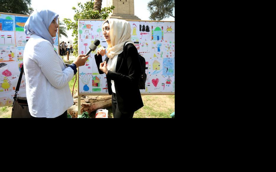 Monte Carlo Radio interviewing the artist Budoor. (Photo: IWPR)