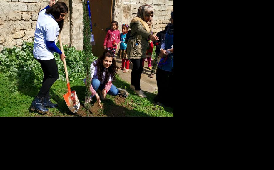 Women of Al-Namrood planting trees for International Women's Day. (Photo: Abdulla al Ahmad/IWPR)