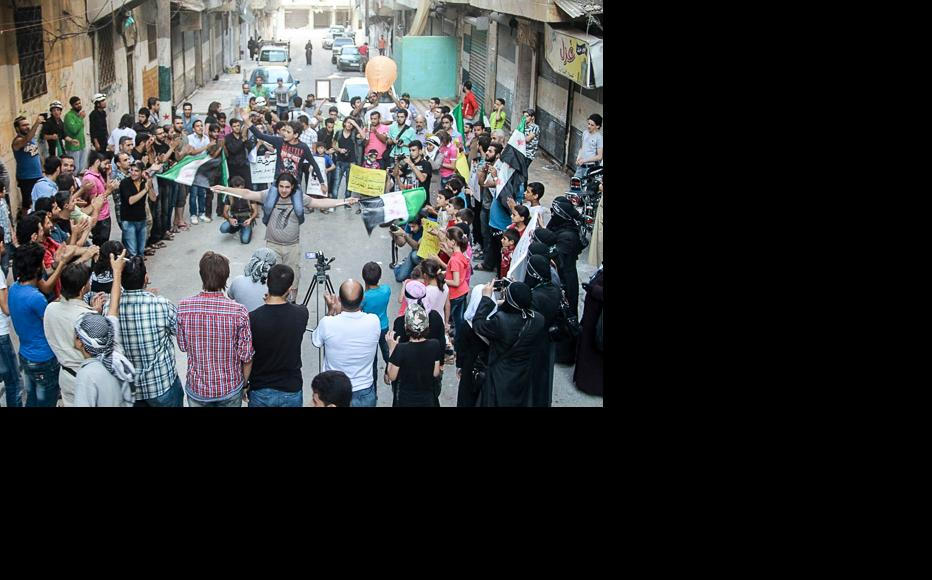 The Syrian revolutionary flag featured prominently during the demonstration. (Photo: Ammar Abdullah)
