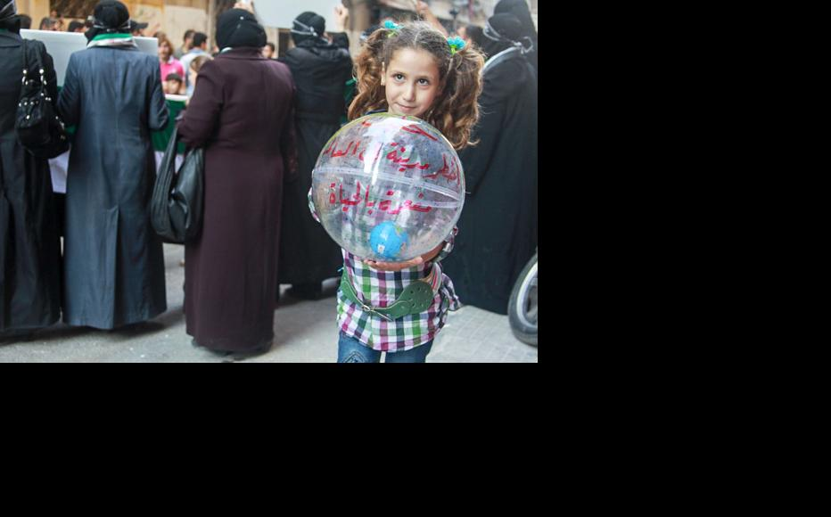 """This balloon says that while Aleppo is """"the most dangerous city in the world"""", it is also """"full of life"""". (Photo: Ammar Abdullah)"""