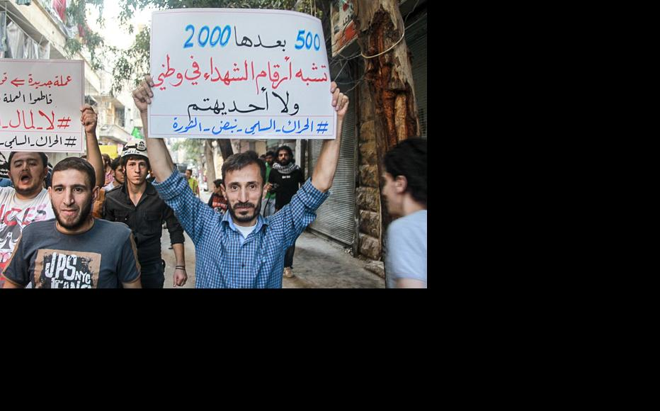 This protester underlines that the bodies of dead Syrians are more than just numbers. (Photo: Ammar Abdullah)