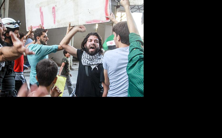 People chant revolutionary songs and slogans that have not been heard in Aleppo's streets for a long time. (Photo: Ammar Abdullah)