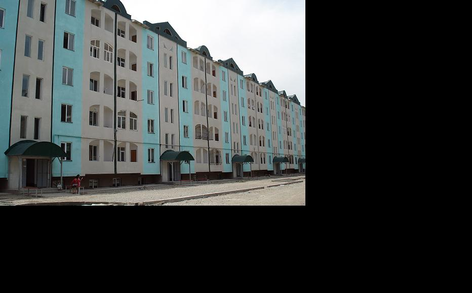 The government has been building new apartment blocks, though some of those assigned flats are unhappy about having neighbours from a different ethnic group. (Photo: Pavel Gromsky)
