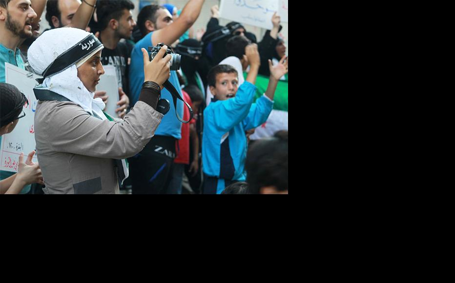 Photographer from the Syrian Women's Association covering a protest in Aleppo. (Photo: Ammar Abdullah)