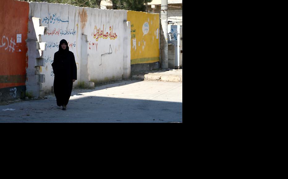 A woman walks in the Salah al-Din neighbourhood. (Photo: Syria Stories)