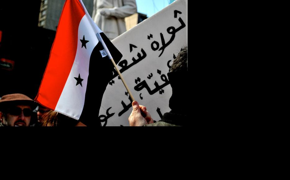 Syrians of Montreal took to the streets on March 27 to show solidarity with anti-regime protesters in Syria. (Photo: Freeedomania/Flickr)