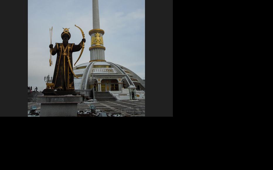 The monument to Turkic mythologic leader Oghuz Khan against the backdrop of a Turkmen independence monument. (Photo: Helen Stevenson)
