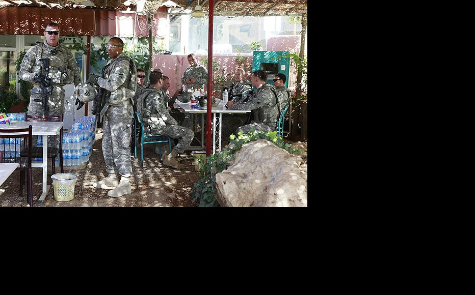 US patrol takes a break at a roadside cafe in Mosul. All combat troops have since left Iraq. (Photo: Tracey Shelton)