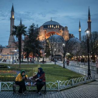 Women break their fast in front of the Hagia Sophia Grand Mosque on April 13, 2021 in Istanbul, Turkey.