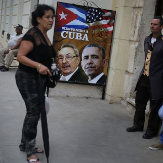 A poster is seen on a wall in an old Havana neighbourhood as Cuba prepares for the visit of US president Barack Obama on 20 March 2016.