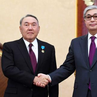 Nazarbayev and Kassym-Zhomart Tokayev during the handover ceremony.