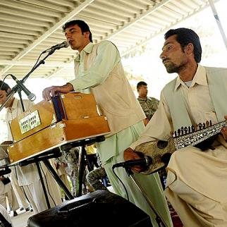 Afghan musicians at a poetry festival in Farah, western Afghanistan, in May 2010. (Photo: US Air Force Senior Airman Rylan K. Albright/ISAF/Wikimedia Commons)