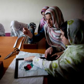 Women work on textiles during vocational training in Kabul. (Photo: Majid Saeedi/Getty Images)