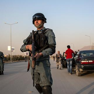 An Afghan National Police officer patrols the streets of Kabul. (Photo: Daniel Berehulak/Getty Images)