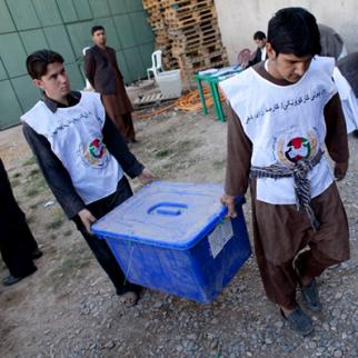 Afghan workers of the Independent Election Commission (IEC) load ballot boxes to be distributed to polling stations. (Photo: Majid Saeedi/Getty Images)