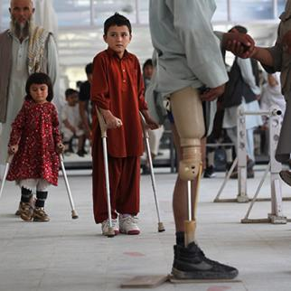 Afghan war amputees and children practice walking at the ICRC orthopaedic centre in Kabul. (Photo: John Moore/Getty Images)
