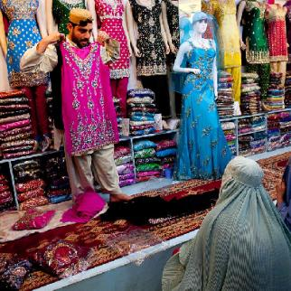 Sales assistants in Afghanistan are traditionally male, but attitudes are changing. (Photo: Majid Saeedi/Getty Images)