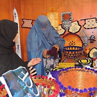 A women entrepreneur in Khost displays her products made from locally available materials. (Photo: Ahmad Salarzai/Flickr)