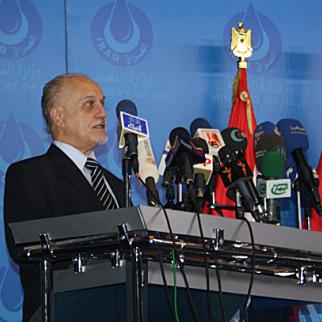 Iraqi oil minister Hussein al-Shahristani addresses the media in Baghdad on October 20 following a landmark auction of three gas fields in Anbar, Diyala and Basra. Provincial officials claim the central government is not cooperating with local authorities to manage natural resources in their regions. (Photo: Khalid Waleed)